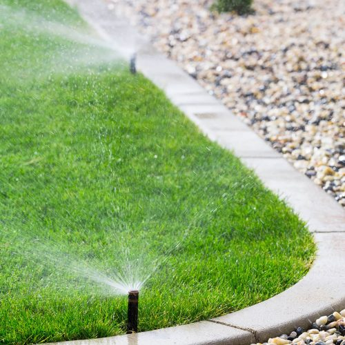 landscape construction Calgary - lawn water sprinkler